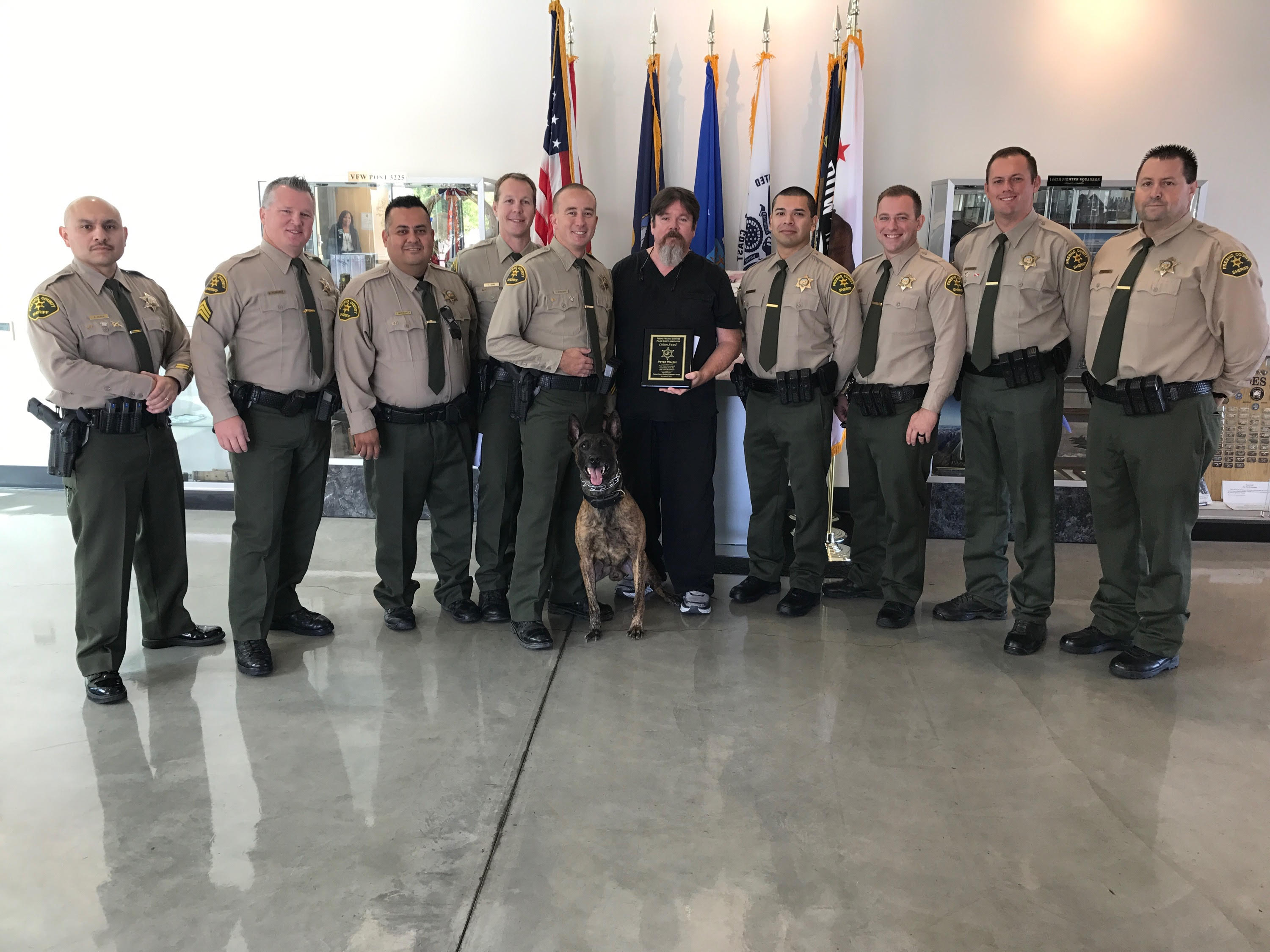 Dr. Walsh With Sheriff department and Service dog